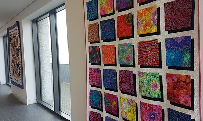 Schoolhouse Quilters exhibition along Boardwalk Gallery at Luan Gallery
